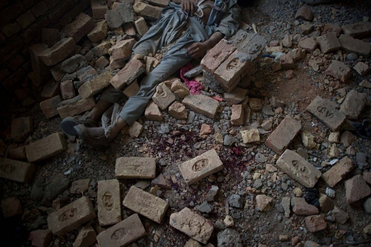 April 16: The dead body of an insurgent lies on the floor inside a building in Kabul. (Johannes Eisele/AFP/Getty Images)