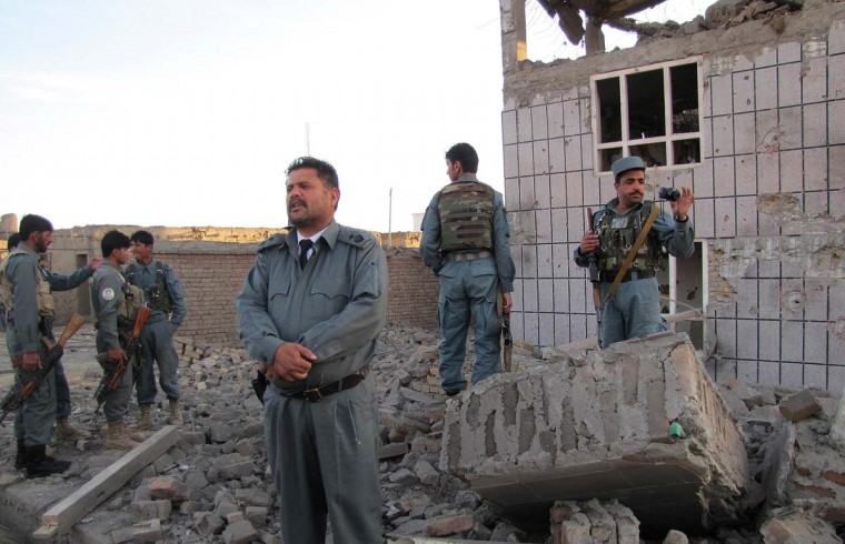 April 16: Afghan police officers secure the area outside a building which Taliban fighters used to launch an attack in Logar province. (Sabawoon Amarkhil/AFP/Getty Images)