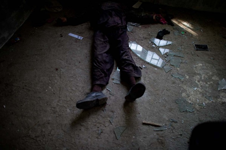 April 16: The dead body of an insurgent lies on the ground inside the building where Taliban fighters launched an attack in Kabul. (Johannes Eisele/AFP/Getty Images)