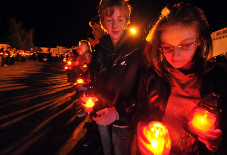 April 26, 2012: Children hold candles at the monument to Chernobyl victims during the early morning memorial ceremony in Slavutich. (Sergei Supinsky/AFP Photo/Getty Images)
