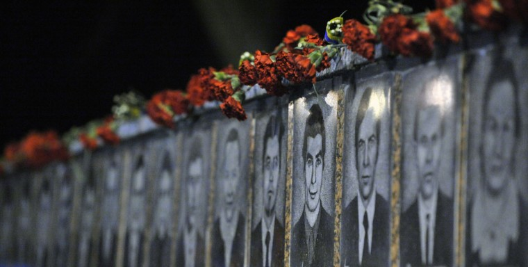 April 26, 2012: Chernobyl victims' portraits are displayed during a memorial ceremony in Slavutich. Some 50 kilometres (30 miles) from the accident site, Slavutich is where many of the power station's personnel used to live. (Sergei Supinsky/AFP/Getty Images)