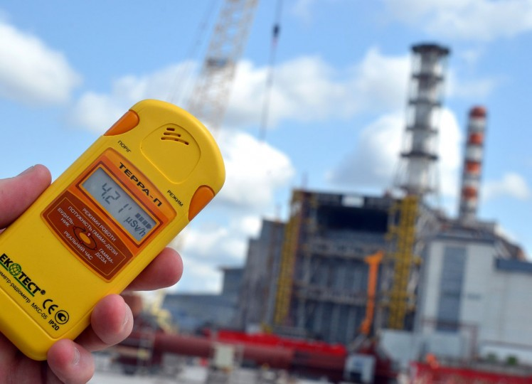 April 26, 2012: A dosimeter reading is seen in front of the shelter over destroyed 4th block of Chernobyl Power Plant. The world on Thursday marks a 26th anniversary since the world's worst nuclear disaster at Chernobyl in Ukraine. (Genya Savilov/AFP Photo/Getty Images)