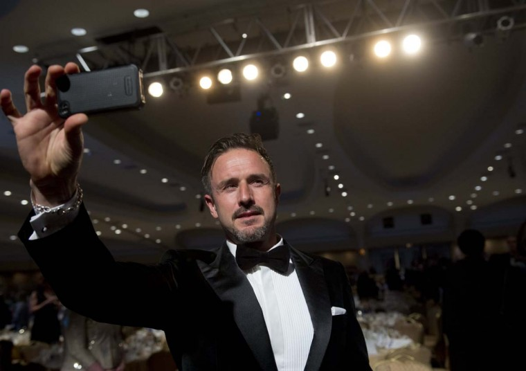 Actor David Arquette films himself as he attends the White House Correspondents Association Dinner. (Saul Loeb/AFP/Getty Images)