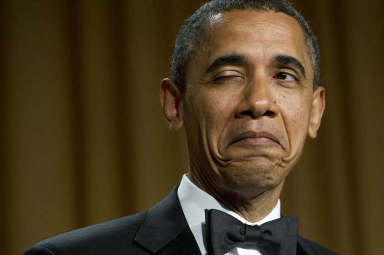 U.S. President Barack Obama winks as he tells a joke about his place of birth during the White House Correspondents Association Dinner in Washington, DC, April 28, 2012. (Saul Loeb/AFP/Getty Images)
