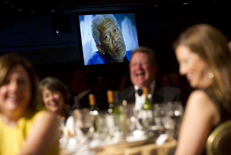 A picture of actor Morgan Freeman appears on a screen as President Barack Obama tells a joke describing what he will look like 4 years from now during the White House Correspondents Association Dinner in Washington, DC, April 28, 2012. (Saul Loeb/AFP/Getty Images)