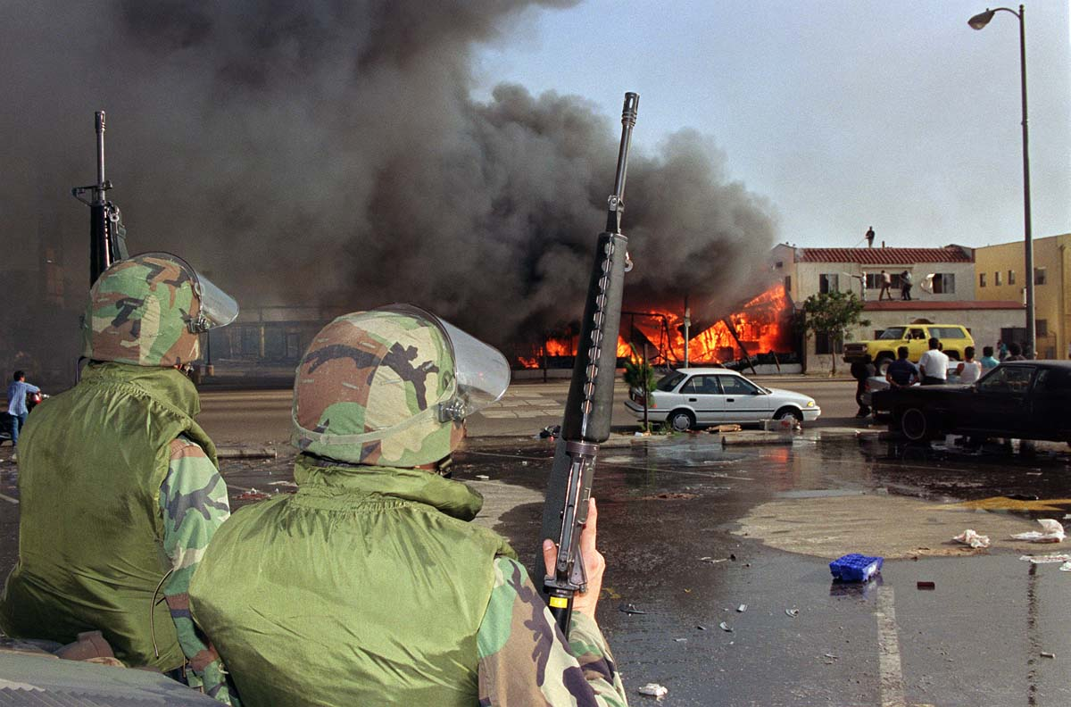 1992 la riots In los angeles, california, four los angeles police officers that had been caught beating an unarmed african-american motorist in an amateur video are acquitted of any wrongdoing in the arrest.