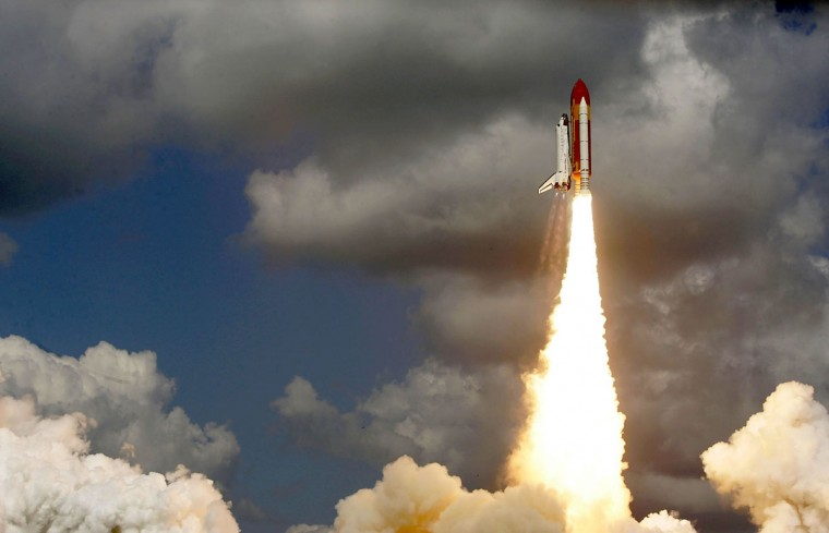 July 26, 2005: Space Shuttle Discovery lifts off of launch pad 39B at the Kennedy Space Center in Cape Canaveral, Florida. Discovery marks NASA's Return to Flight mission, two and a half years after the break-up of Shuttle Columbia. (Mark Wilson/Getty Images)