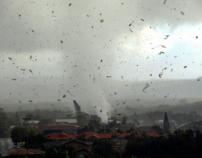 Debris flies through the air as a freak tornado tears through the Australian coastal town of Lennox Head on June 3, 2010. The storm leveled 12 homes and damaged another 30, with twisting winds carving out a 300 metre-wide path of destruction, injuring six people and leaving thousands without power. (Ross Tuckerman/AFP/Getty Images)