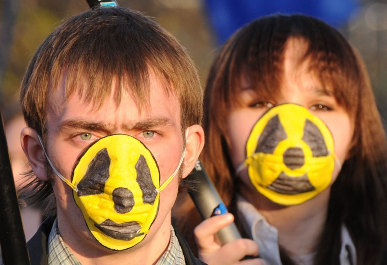 April 26, 2010: Young Belarusian protesters take part in a rally to commemorate Chernobyl nuclear disaster in Minsk. Several hundred people gathered in Minsk to mark the 24th anniversary of the Chernobyl nuclear disaster, in what has become an annual gathering of opposition activists. (Victor Drachev/AFP/Getty Images)