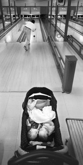At Southway Bowling Center, Paul Hazlehurst goes Duckpin bowling as his twins, Matthew and Grace sleep soundly. Southway closed a few days later in November 2000. (Algerina Perna/Baltimore Sun)