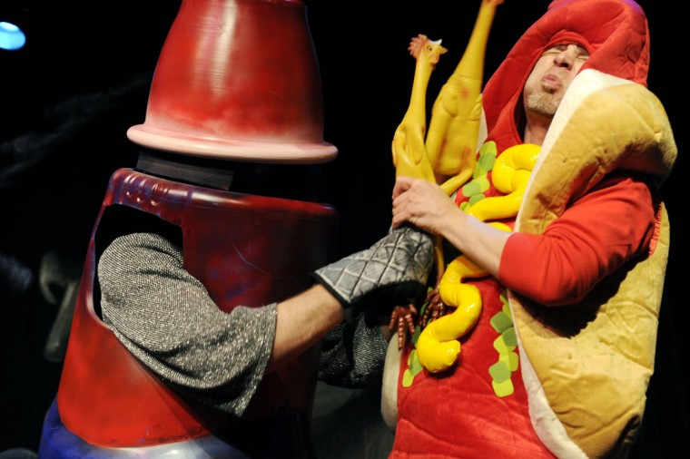 Jan. 16: The robot slaps the hot dog with a rubber chicken at the Elvis Birthday Fight Club at Creative Alliance. (Colby Ware/Baltimore Sun)