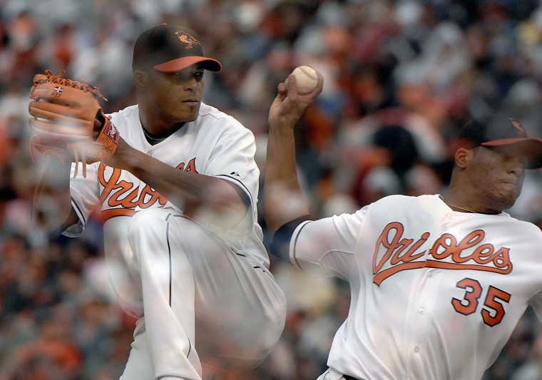 2007: Orioles Opening Day. Shown is a multiple exposure composite photo of Orioles starting pitcher Daniel Cabrera, during the 7th inning. (Doug Kapustin/Baltimore Sun) BUY THIS PHOTO