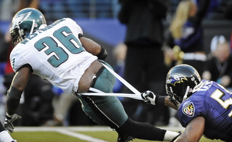 Ravens linebacker Antwan Barnes, right, stops Eagles running back Brian Westbrook by the seat of his pants, relatively speaking, for a two-yard loss in the third quarter of their game in November of 2008. (Christopher T. Assaf/Baltimore Sun)