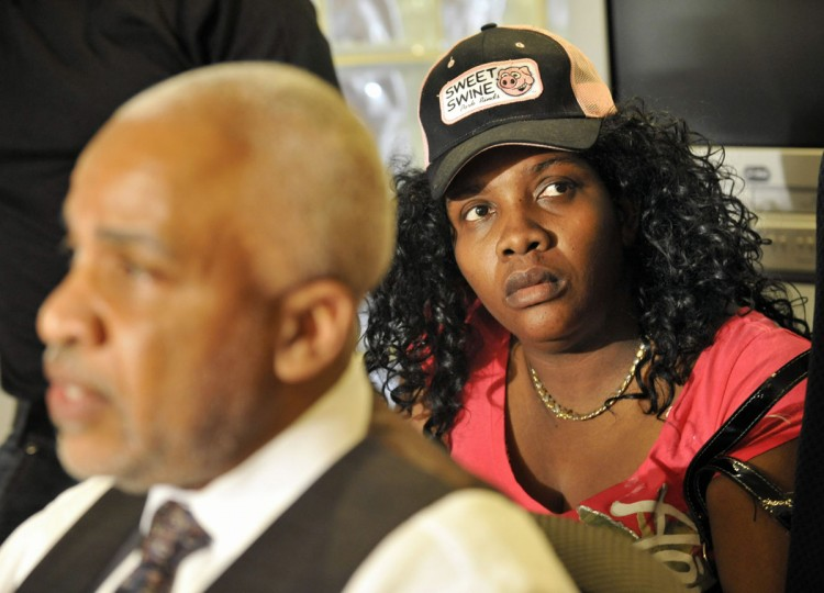 Apr. 5: Attorney Edward Smith Jr. and his client Mirlande Wilson (R), who claims she has won the Maryland Mega Millions. (Lloyd Fox/Baltimore Sun)