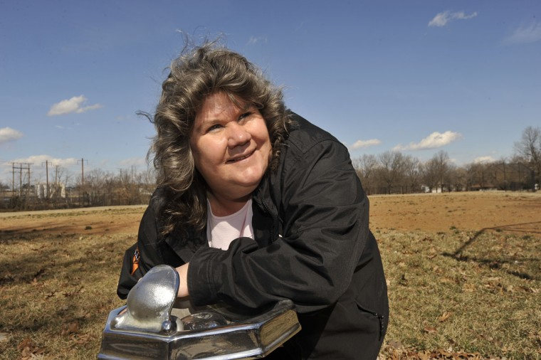 Feb. 26: Linda Stewart, an activist who tracks the city's water billing, leans on one of two non-working water fountains in Violetville Park. Despite the fact that neither fountain works nor the concession stand, Stewart says the water bill for 3 months at the park was $9000. (Kim Hairston/Baltimore Sun)