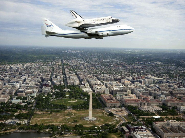 April 17, 2012: The space shuttle Discovery is tethered to the back of NASA 905 Shuttle Carrier Aircraft (SCA), a modified Boeing 747 jumbo jet, as it as it does a fly over of the U.S. Capitol in Washington, DC. (Robert Markowitz/NASA/Getty Images)