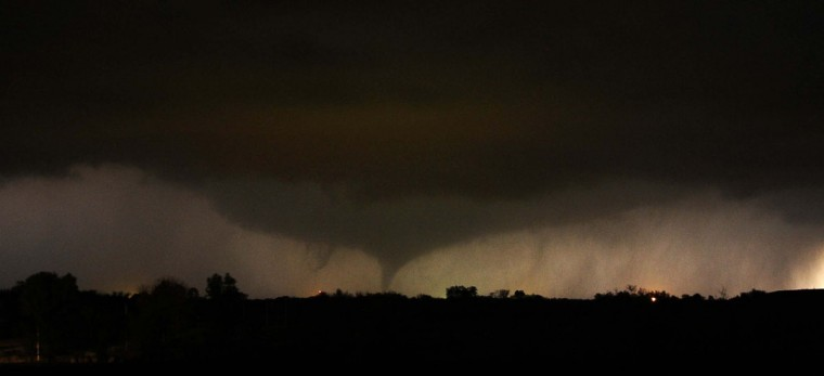 A tornado on the ground makes it way through the night near Salin, Kansas, during the third day of severe weather and multiple tornado sightings, April 14, 2012. A spate of tornadoes tore through parts of Oklahoma, Kansas, Nebraska and Iowa, churning through Wichita and other areas, causing widespread damage and killing two. (Gene Blevins/Reuters)