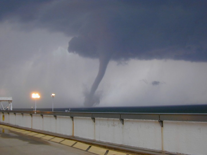The funnel cloud of an F5 tornado passes right by the wall of the Calvert Cliffs Nuclear Power plant, after touching down in La Plata, MD. (Photo by a Calvert Cliffs employee who wants to remain anonymous)