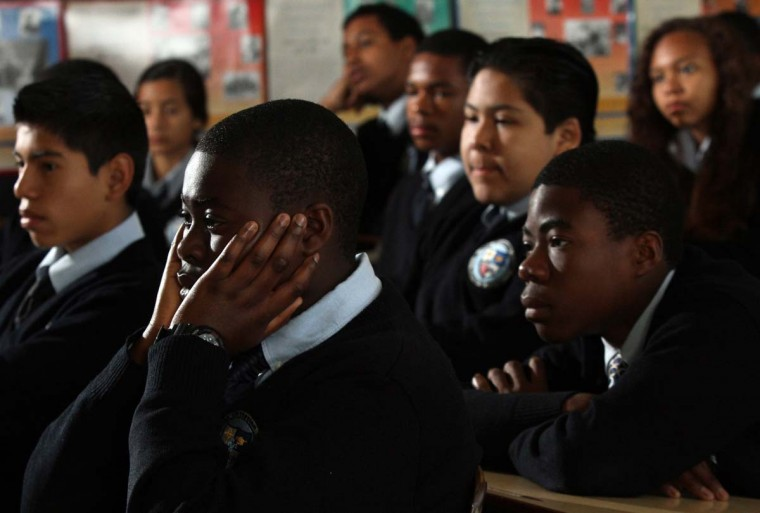 April 5, 2012: James Jennings, 14, holds his face in his hands as he and classmates watch a video of the riots during an educational discussion with eighth graders about riots in Los Angeles and race relations at St. John Chrysostom Catholic Church in Inglewood, California. (Irfan Khan/Los Angeles Times/MCT)