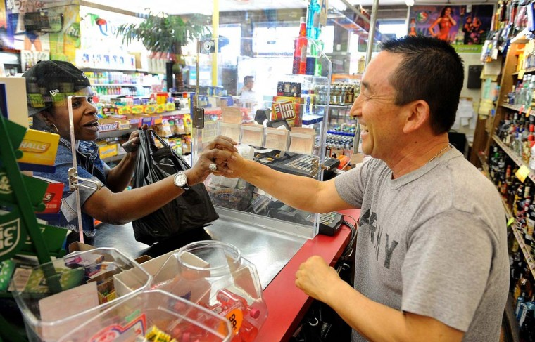 April 5, 2012: Tom's Liquor owner James Oh greets a customer at the store in South Los Angeles, California. The store is at the intersection of Florence and Normandy Avenues. (Wally Skalij/Los Angeles Times/MCT)