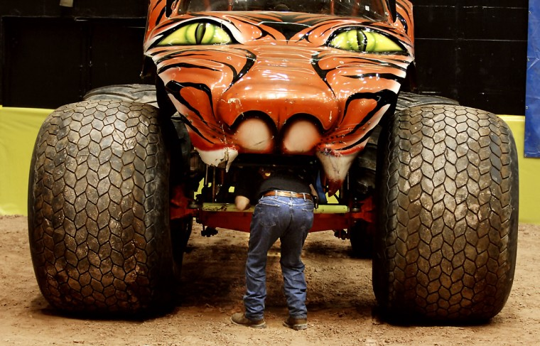 In February 2008, Lenny Kulider, driver of the Prowler monster truck, appears to be getting eaten by his machine when he is in fact working on the truck prior to the start of Monster Jam at the 1st Mariner Arena. (Lloyd Fox/Baltimore Sun)