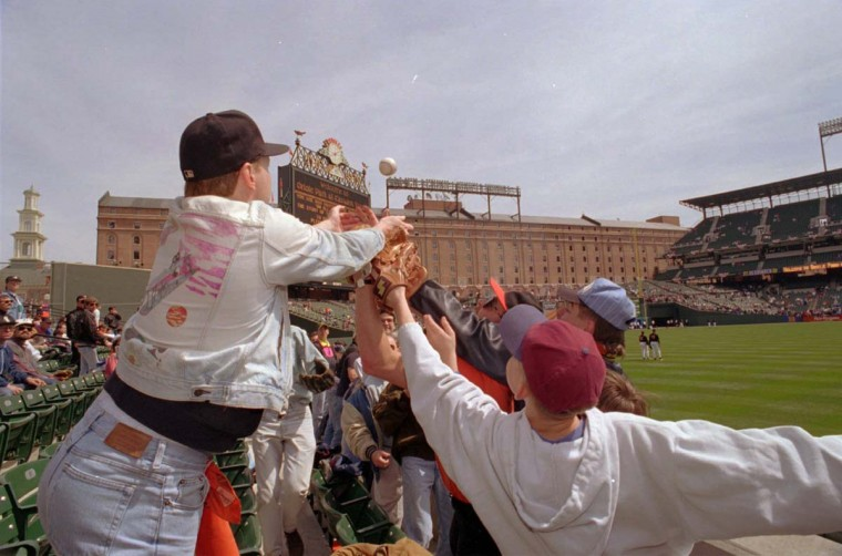 1994: Fans go for the ball during the Opening Day game at Camden Yards. (Karl M. Ferron/Baltimore Sun)
