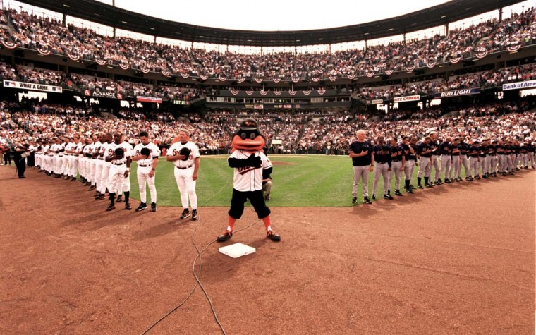 2000: Orioles Opening Day. Both teams and the Oriole Bird during the National Anthem. (Gene Sweeney Jr./Baltimore Sun) BUY THIS PHOTO