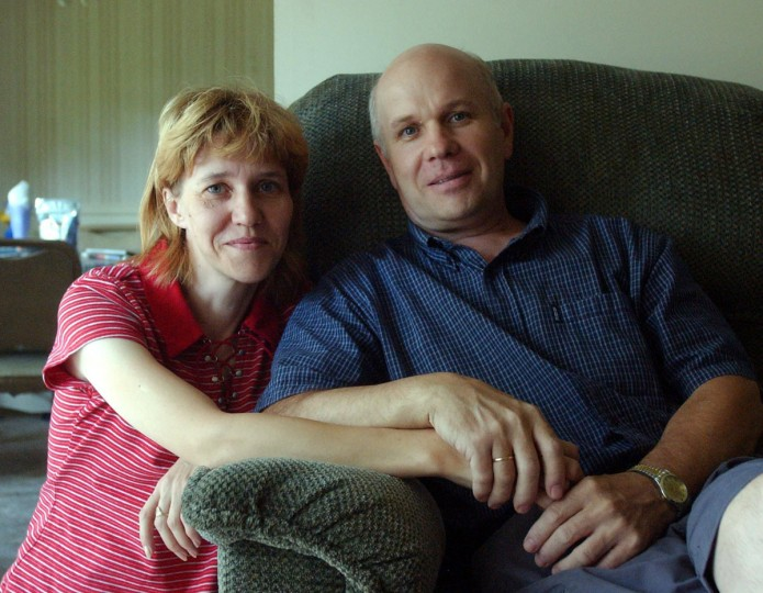 September 2, 2004: One month after surgeons successfully removed cancer that had spread from his kidney to his lungs, Yuriy Olyshko is recovering at home with his wife, Natalya, in their Rosedale apartment. Olyshko worked as a liquidator (clean-up workers at the reactor complex), in 1986 after a nuclear reactor exploded and released radioactive fission products released during the core meltdown into the atmosphere. (Patuxent Publishing)