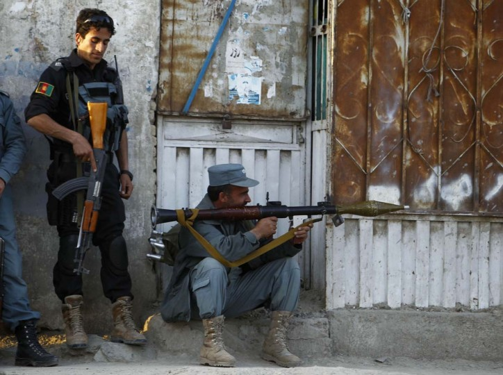 April 15: Afghan policemen take position at the site of an attack in Kabul. Gunmen launched multiple attacks in the Afghan capital Kabul on Sunday, assaulting Western embassies in the heavily guarded, central diplomatic area and at the parliament in the west, witnesses and officials said. (Omar Sobhani/Reuters)