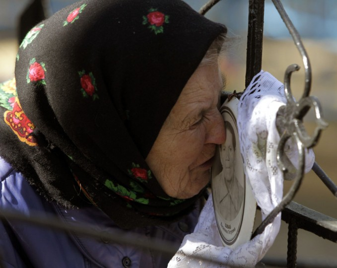 April 24, 2012: A Belarussian woman kisses a portrait at her relative's grave during Radunitsa, a holiday in the Eastern Orthodox Church to remember the dead, in the abandoned village of Lomysh, near the exclusion zone around the Chernobyl nuclear reactor, some 370 km (230 miles) southeast of Minsk. (Vasily Fedosenko/Reuters)