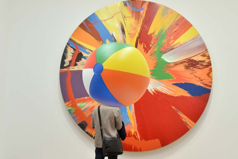 A visitor views a spin painting by British artist Damien Hirst at the Tate Modern gallery in London. (Toby Melville/Reuters)