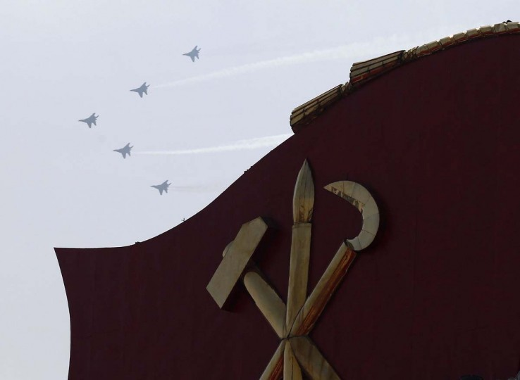April 15: Fighter jets fly past during a military parade to celebrate the centenary of the birth of Kim Il-sung in Pyongyang. (Bobby Yip/Reuters)