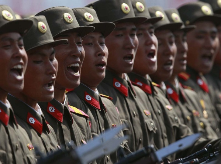 April 15: Soldiers shout as they march past the podium during a military parade to celebrate the centenary of the birth of North Korea's founder Kim Il-sung in Pyongyang. (Bobby Yip/Reuters)
