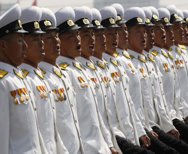 April 15: Naval soldiers shout as they march past the podium during a military parade to celebrate the centenary of the birth of North Korea founder Kim Il-sung in Pyongyang. (Bobby Yip/Reuters)