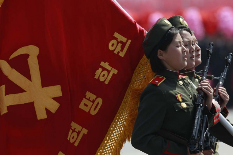 April 15: Female soldiers carrying a flag march past the podium during a military parade to celebrate the centenary of the birth of North Korea founder Kim Il-sung. (Bobby Yip/Reuters)