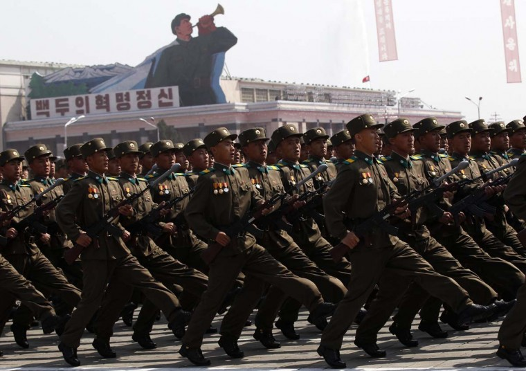 April 15: Soldiers shout as they march past the podium during a military parade to celebrate the centenary of the birth of North Korea founder Kim Il-sung in Pyongyang. (Bobby Yip/Reuters)