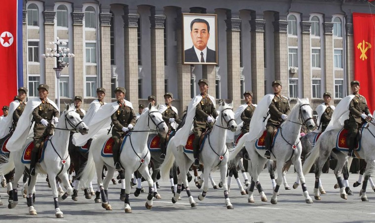 April 15: Soldiers on horseback take part in a military parade to celebrate the centenary of the birth of North Korea's founder Kim Il-sung in Pyongyang. (Bobby Yip/Reuters)