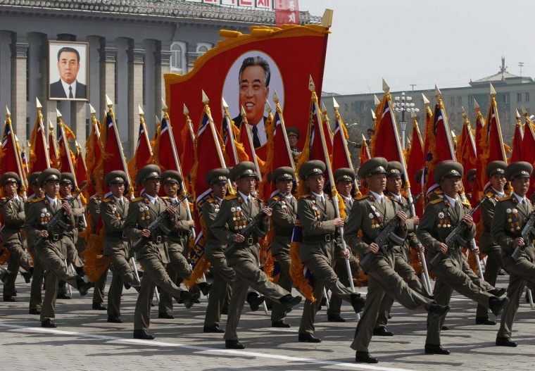 April 15: Soldiers carry an image of North Korea's founder Kim Il-sung during a military parade to celebrate the centenary of his birth in Pyongyang. (Bobby Yip/Reuters)