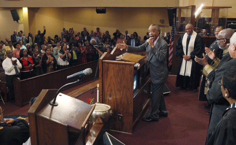 April 29, 2012: The Rev. Al Sharpton, a community organizer and a daily politics show host on MSNBC, is applauded as he delivers Sunday service sermon at First AME Church in Los Angeles, California. Sharpton called for non-violence in fighting injustice. (Hyungwon Kang/Reuters)