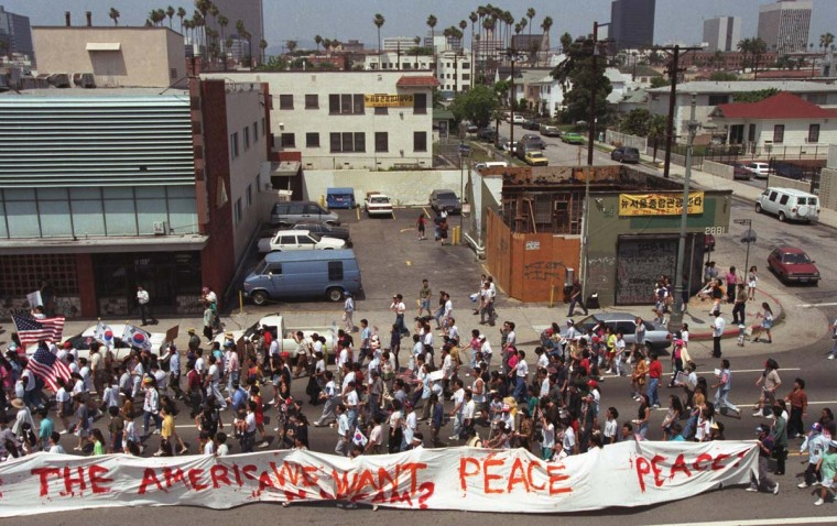 May 2, 1992: People march calling for peace during the Los Angeles Riots in Koreatown. (Hyungwon Kang/Los Angeles Times/Files/Reuters)
