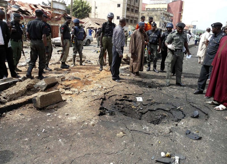 BOKO HARAM: Security officials assess the scene of a bomb blast on April 8, 2012 in Nigeria's northern city of Kaduna. Suspected members of Nigerian Islamist sect Boko Haram have killed four people and a large undetonated bomb was found in Kano on Monday, authorities said, a day after at least 36 people were killed in a car bomb near a church in northern Kaduna. (Stringer/Reuters)