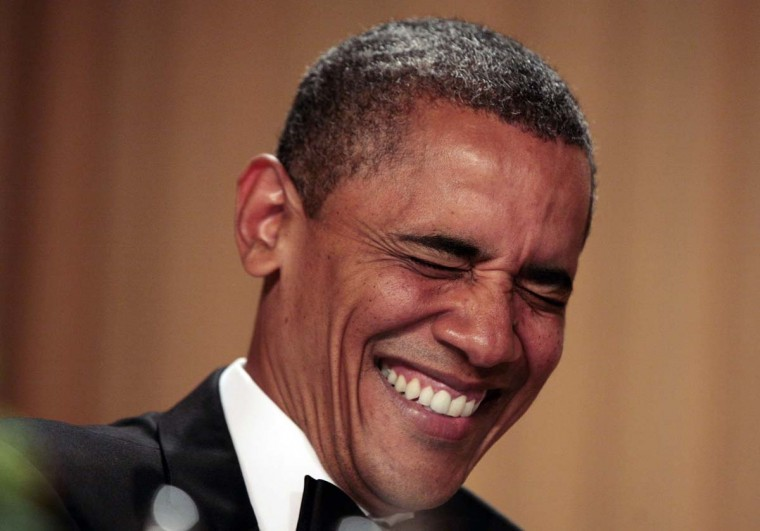 U.S. President Barack Obama laughs during the White House Correspondents Association annual dinner in Washington April 28, 2012. (Larry Downing/Reuters)