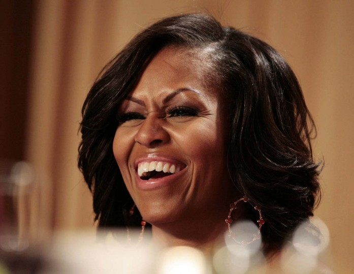 U.S. first lady Michelle Obama laughs at comedian Jimmy Kimmel at the White House Correspondents Association annual dinner in Washington April 28, 2012. (Larry Downing/Reuters)
