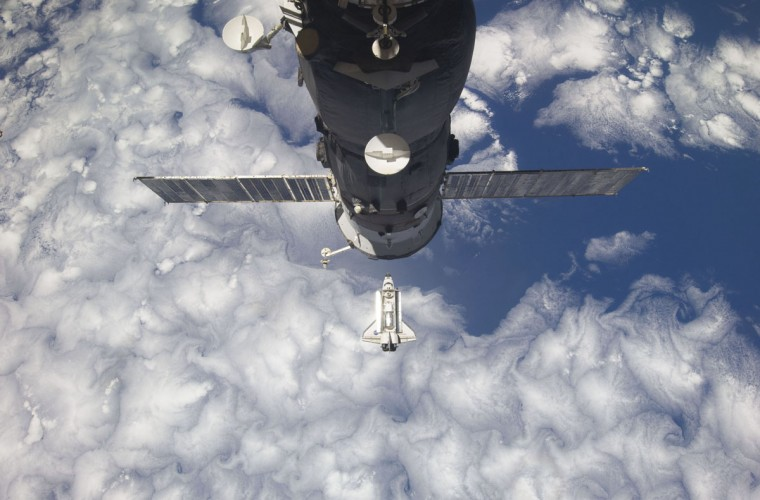 February 26, 2011: The space shuttle Discovery is seen with Earth in the background as the shuttle approaches the International Space Station for docking in this photograph by an Expedition 26 crew member. Shuttle Discovery astronauts worked alongside the International Space Station crew on Sunday to prepare the orbital outpost for life after the United States retires its three existing spaceships. (NASA/Reuters)