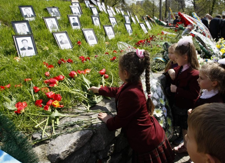 April 26, 2012: Children lay flowers at a monument to victims of the Chernobyl nuclear disaster in Kiev. Ukraine marked the 26th anniversary on Thursday of the world's worst nuclear accident at its Chernobyl power plant. (Anatolii Stepanov/Reuters)