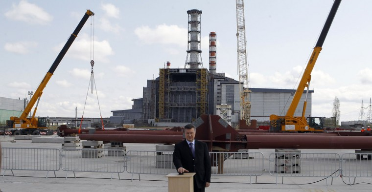 April 26, 2012: Ukraine launched construction of a new containment shelter to permanently secure the stricken Chernobyl plant as it marked the 26th anniversary of the world's worst nuclear disaster. President Viktor Yanukovych pressed a symbolic button at the construction site, watched by workers and ambassadors from China, Japan and a number of other countries that contributed to the massive project, expected to cost 1.5 billion euros. (Gleb Garanich/Reuters)
