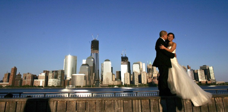 A couple, posing for their pre-wedding photographs, are back-dropped by the One World Trade Center and Manhattan skyline as seen from New Jersey. (Eduardo Munoz/Reuters)