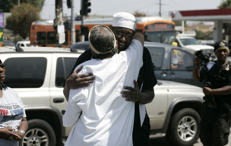 April 29, 2012: People embrace at the intersection of Florence and Normandie. (Jonathan Alcorn/Reuters)
