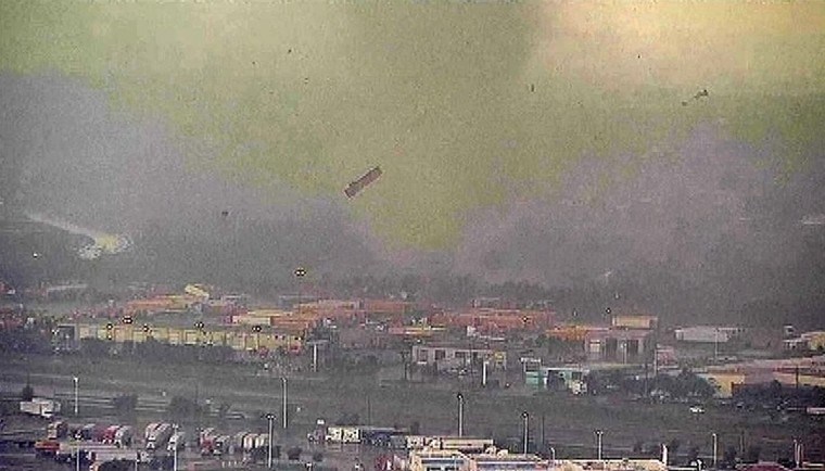 A trailer flies through the air as a tornado sweeps through the Dallas-Fort Worth area April 3, 2012 in this still image taken from video. One or more tornadoes touched down in the Dallas-Fort Worth metropolitan area on Tuesday, tossing tractor trailer trucks into the air and causing some damages to homes, according to local television. (Reuters)