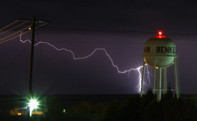 A lightning strike is seen near the water tower of Benkelman, Nebraska April 12, 2012. (Gene Blevins/Reuters)